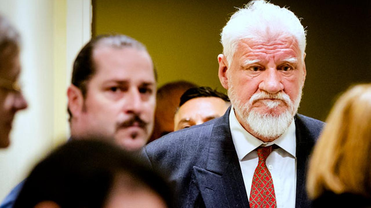 Slobodan Praljak enters the Yugoslav War Crimes Tribunal in The Hague, Netherlands, Wednesday, Nov. 29, 2017, to hear the verdict in the appeals case.