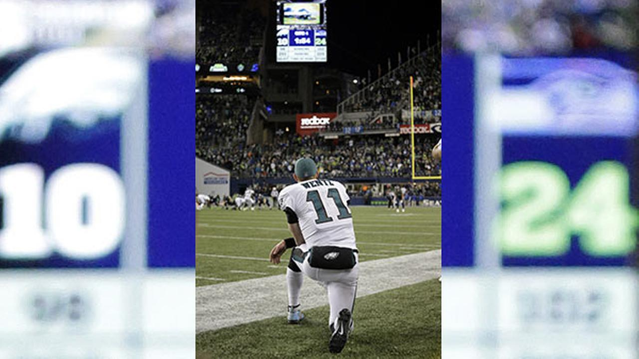 Philadelphia Eagles quarterback Carson Wentz looks on from the sidelines for the final moments in the second half of an NFL football game against the Seattle Seahawks.