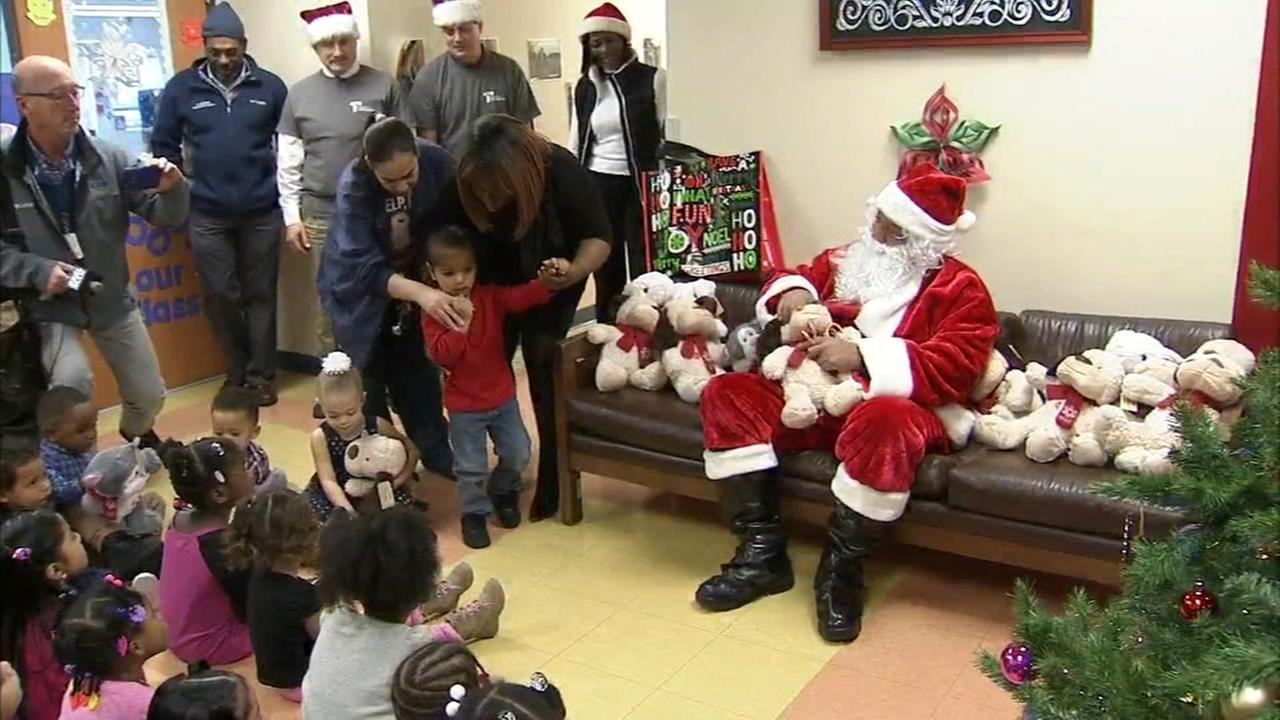 Construction workers surprise children with toys in Camden