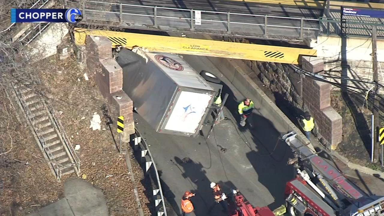 Truck stuck removed after hitting rail overpass in Wayne