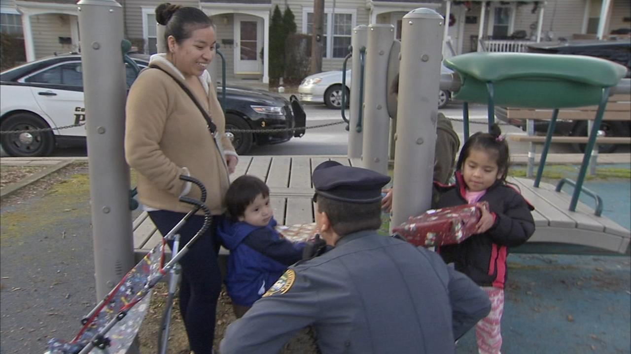 Chester County police officers hand out gifts to children