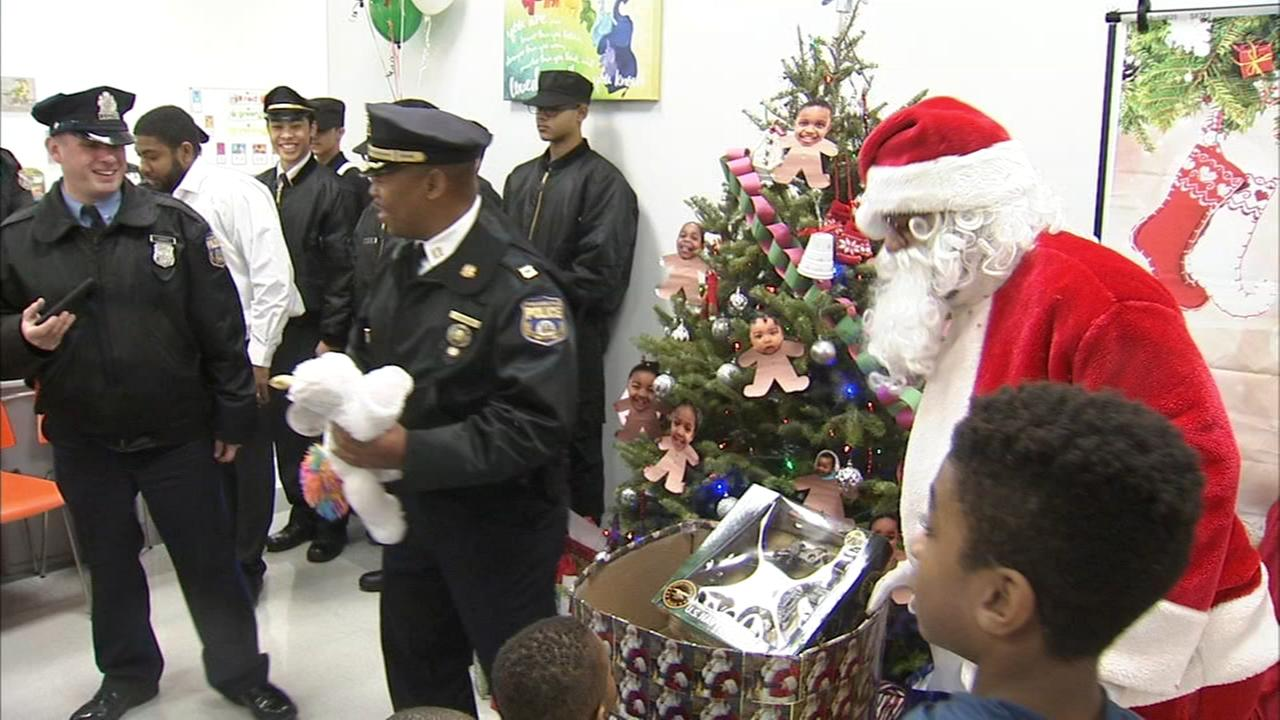 Officers deliver gifts to Olney daycare center