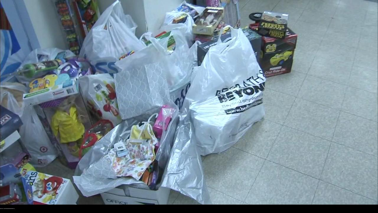 United States Probation Office delivers toys to womens shelter in Camden