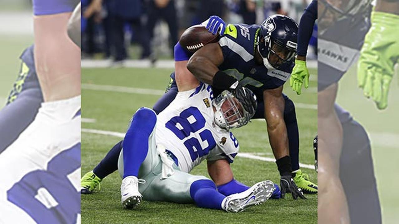 Dallas Cowboys tight end Jason Witten (82) is tackled after catching a pass by Seattle Seahawks defensive end Dion Jordan (95) in the second half of an NFL football game.