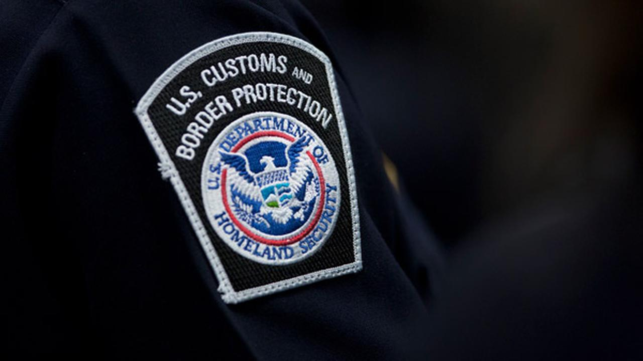 A customs agent wears a patch for the U.S. Customs and Border Protection agency, Friday, Oct. 27, 2017, at John F. Kennedy International Airport.