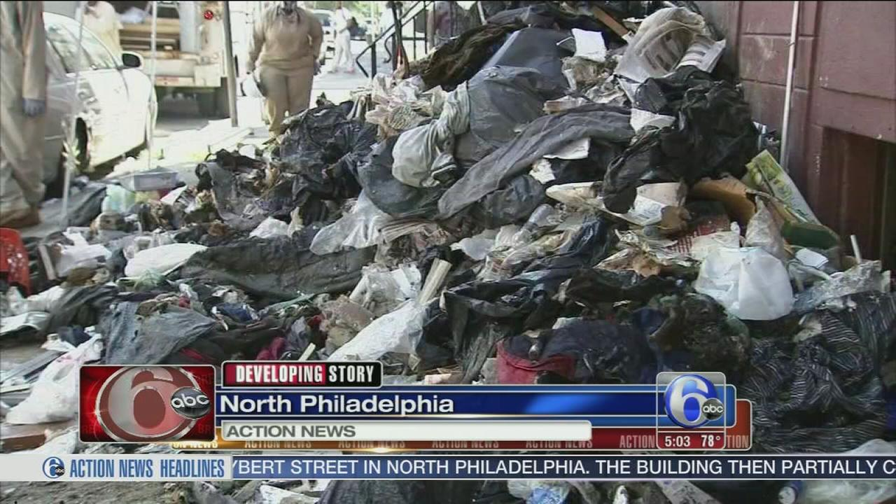 VIDEO: Piles of trash pulled from home in North Philadelphia