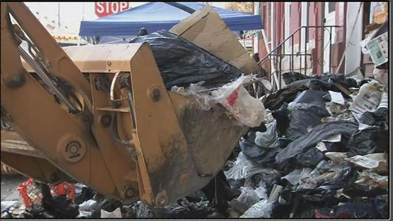 PHOTOS: Backhoe used to clear trash from N. Phila house