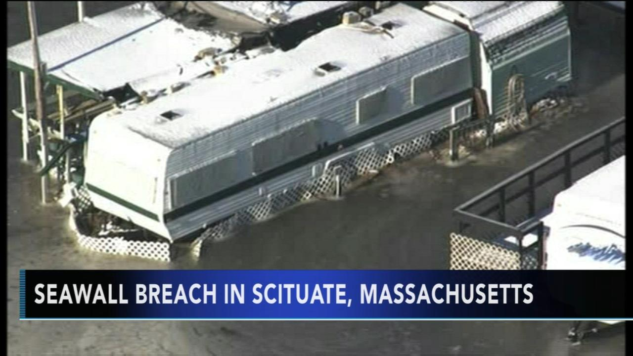 Sea wall breach causes evacuations in Mass.