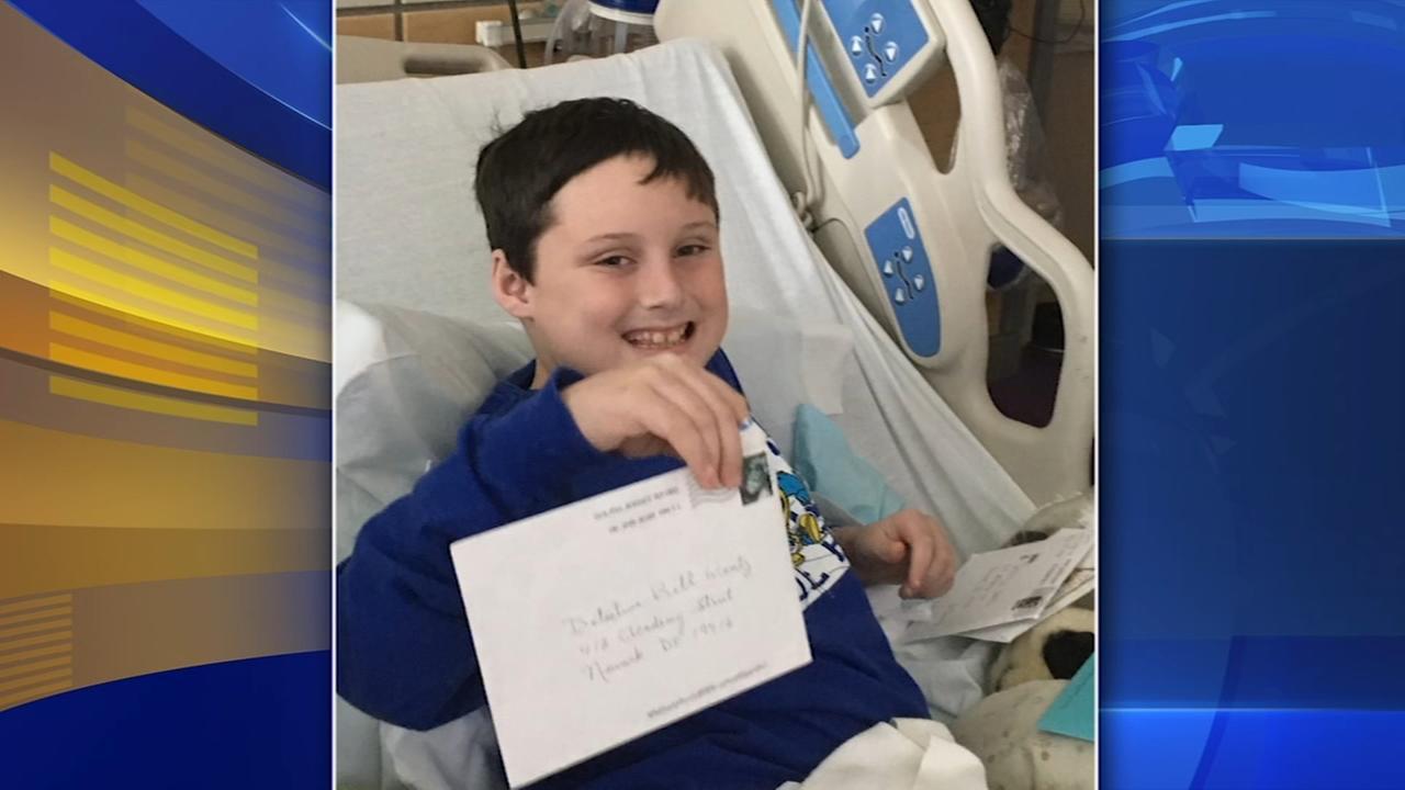 9-year-old boy battling cancer gets parade outside hospital window