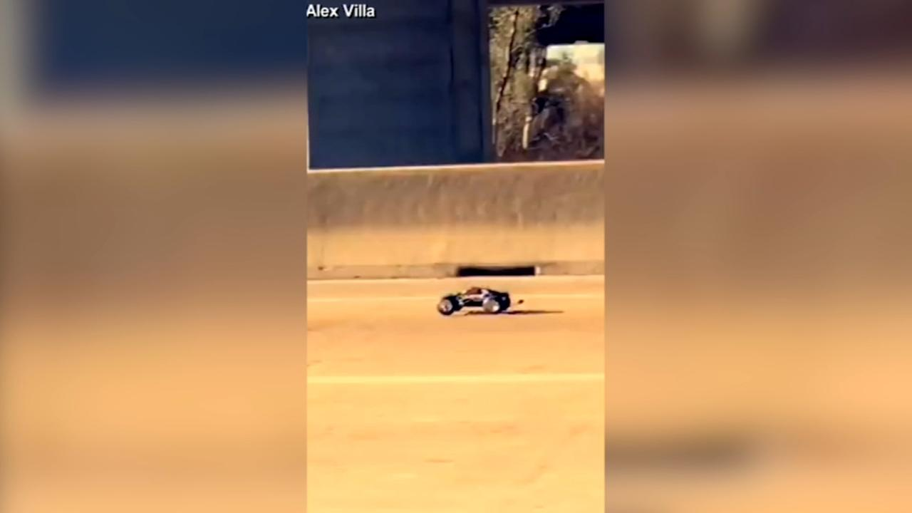 TOY STORY: RC car chases white pickup truck on highway