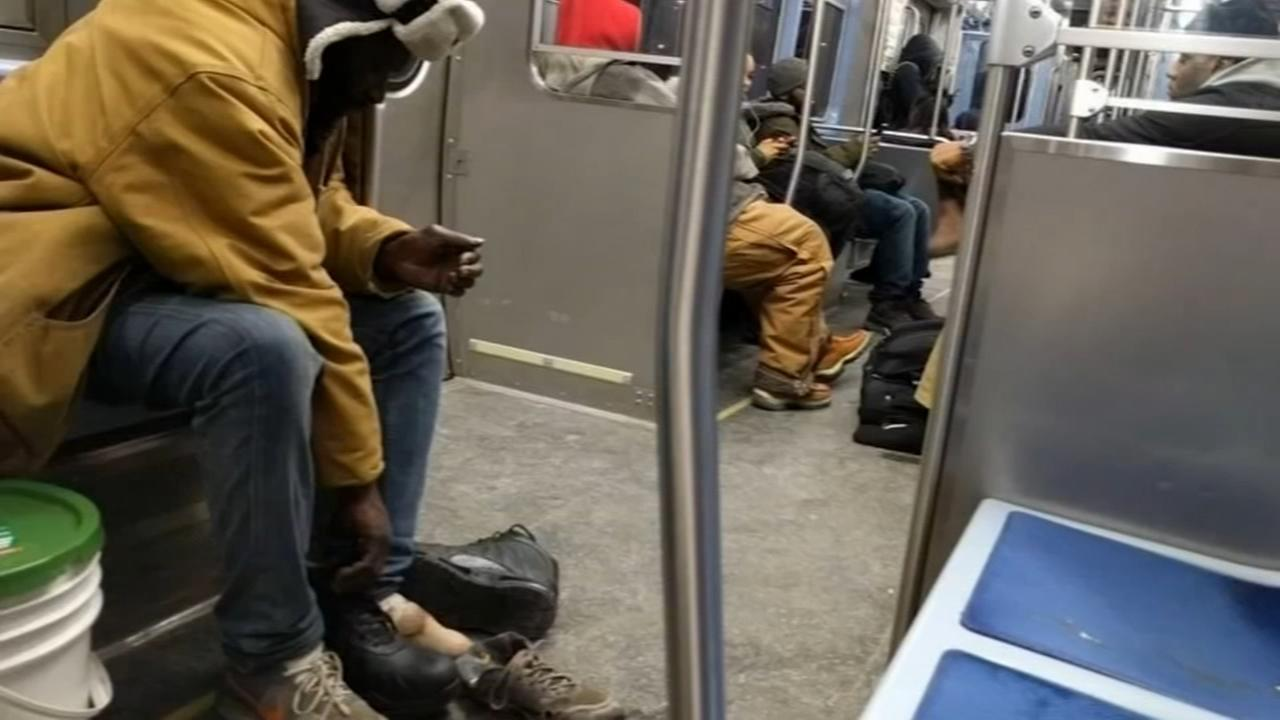 Train passenger gives homeless man his shoes