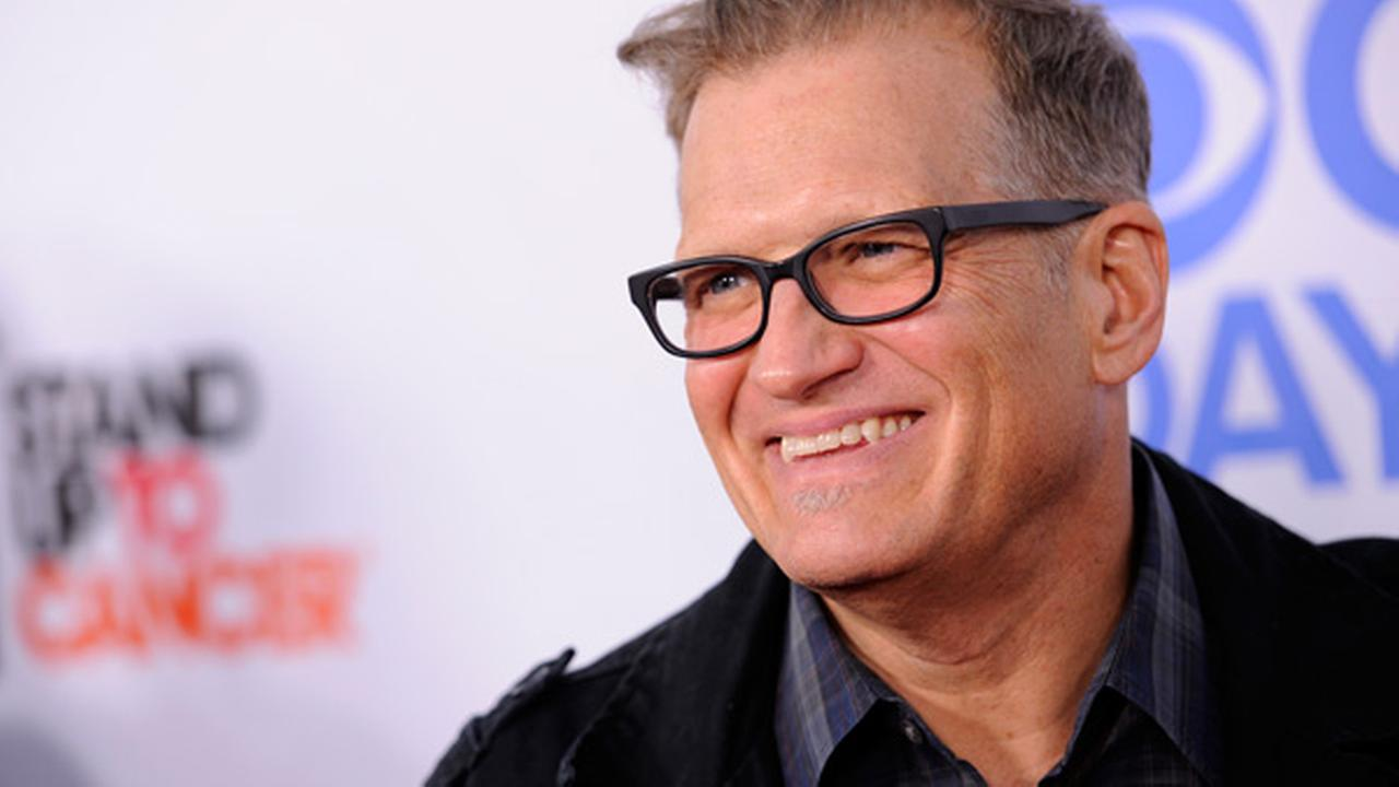 FILE - In this Oct. 8, 2013 file photo, Drew Carey arrives at the CBS Daytime After Dark comedy event at The Comedy Store in West Hollywood, Calif.