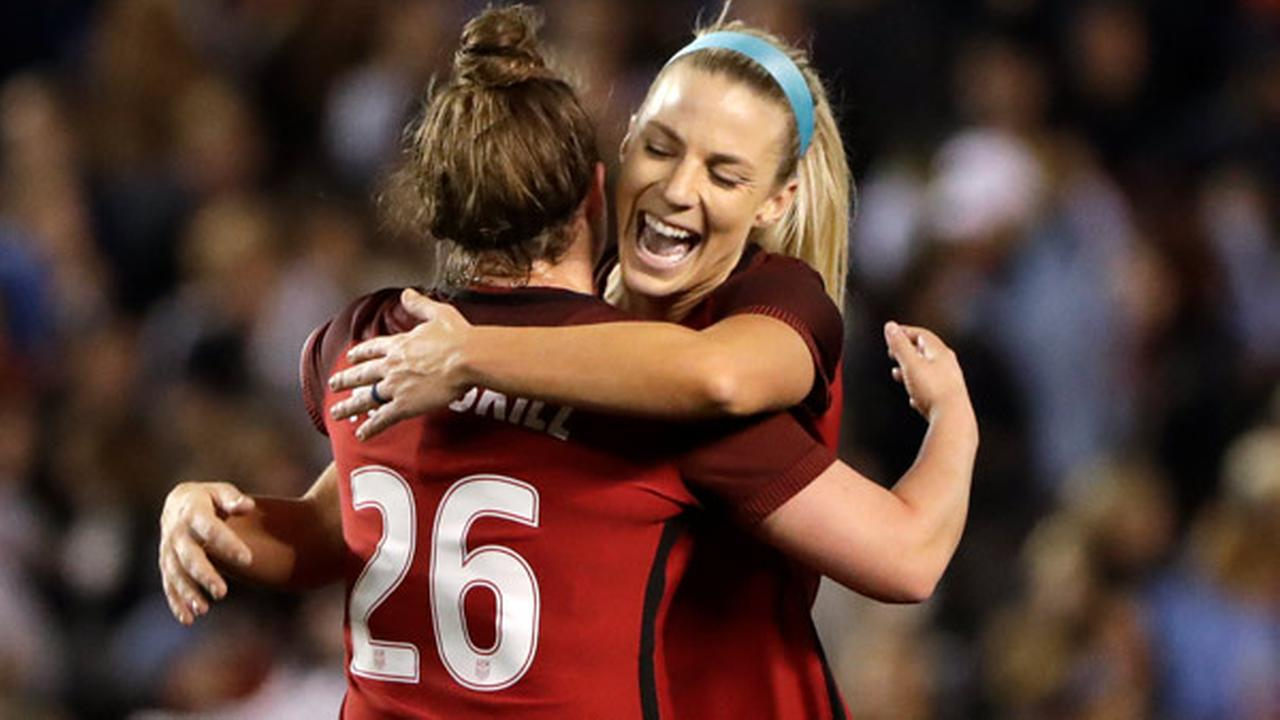 United States midfielder Julie Ertz, right, hugs teammate Savannah McCaskill after defeating Denmark in an international friendly soccer match Sunday, Jan. 21, 2018, in San Diego.