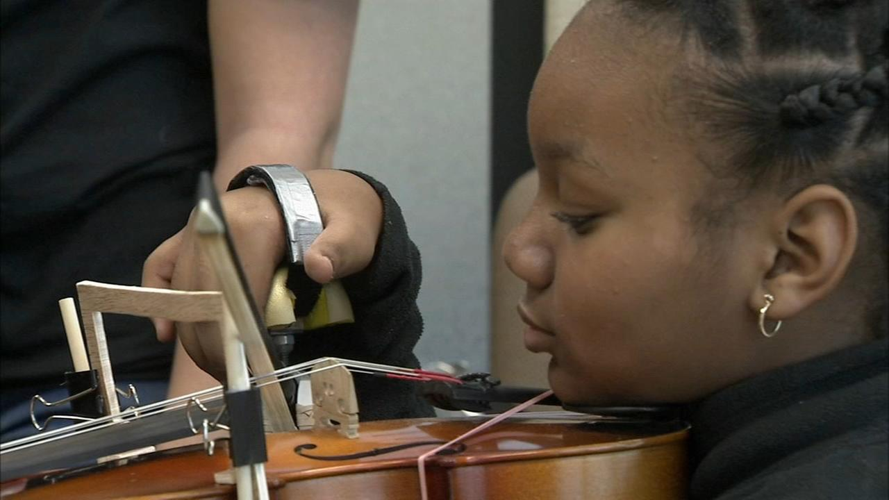 Students design hand brace to help 4th grader play viola