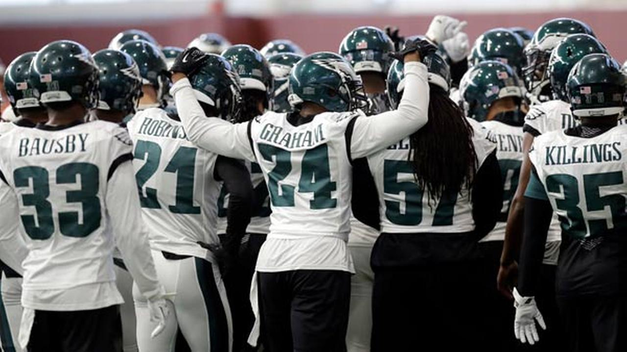 Philadelphia Eagles defensive back Corey Graham (24) reaches around teammates as the team huddles during a practice for the NFL Super Bowl 52 football game Wednesday, Jan. 31, 2018