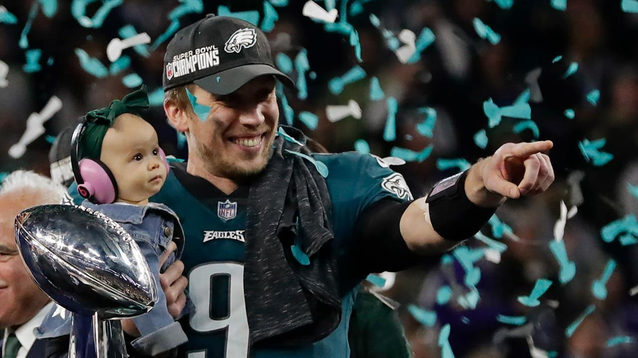Philadelphia Eagles quarterback Nick Foles (9) holds his daughter, Lily James, after winning Super Bowl 52 on Sunday, Feb. 4, 2018, in Minneapolis.