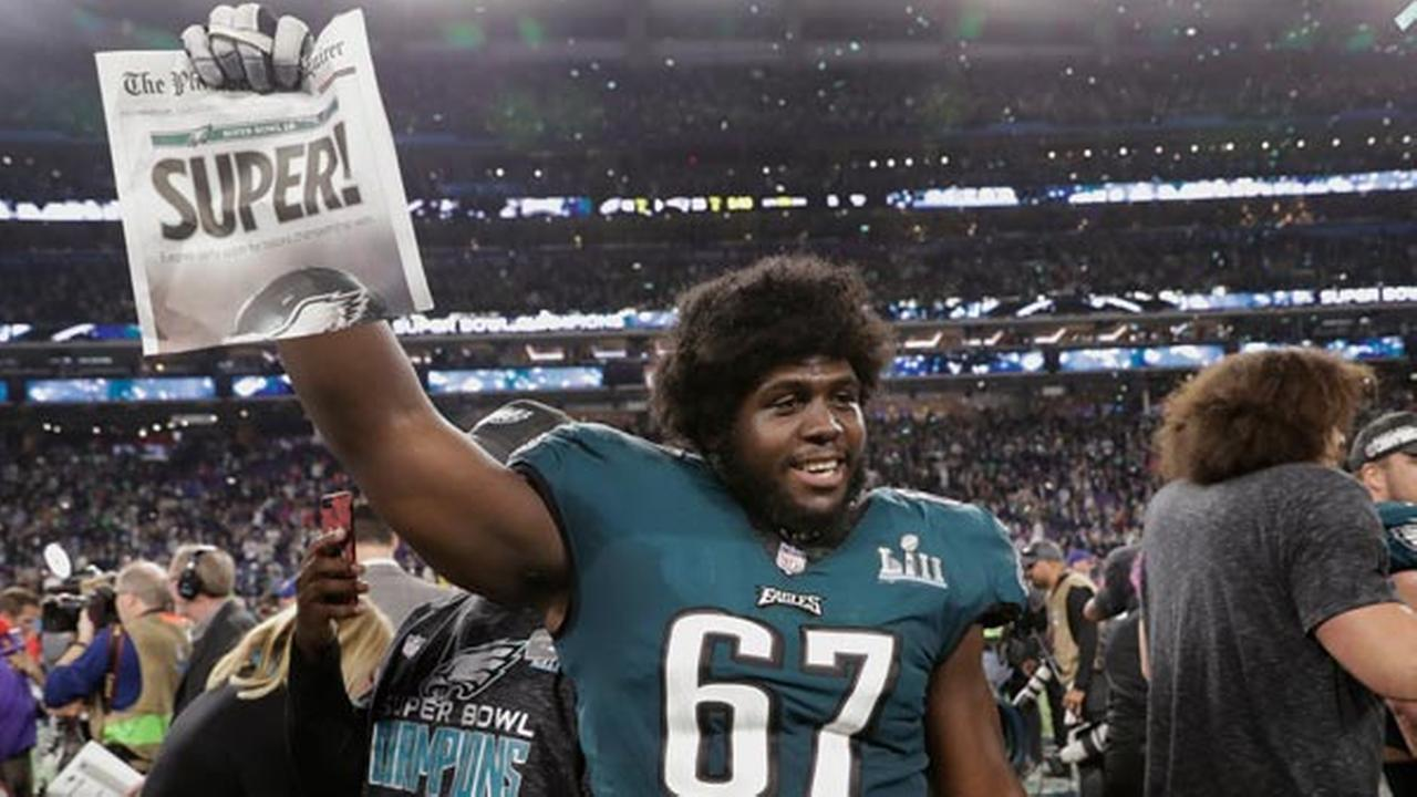 Philadelphia Eagles offensive guard Chance Warmack (67) holds up a newspaper after winning Super Bowl 52 against the New England Patriots, Sunday, Feb. 4, 2018, in Minneapolis.