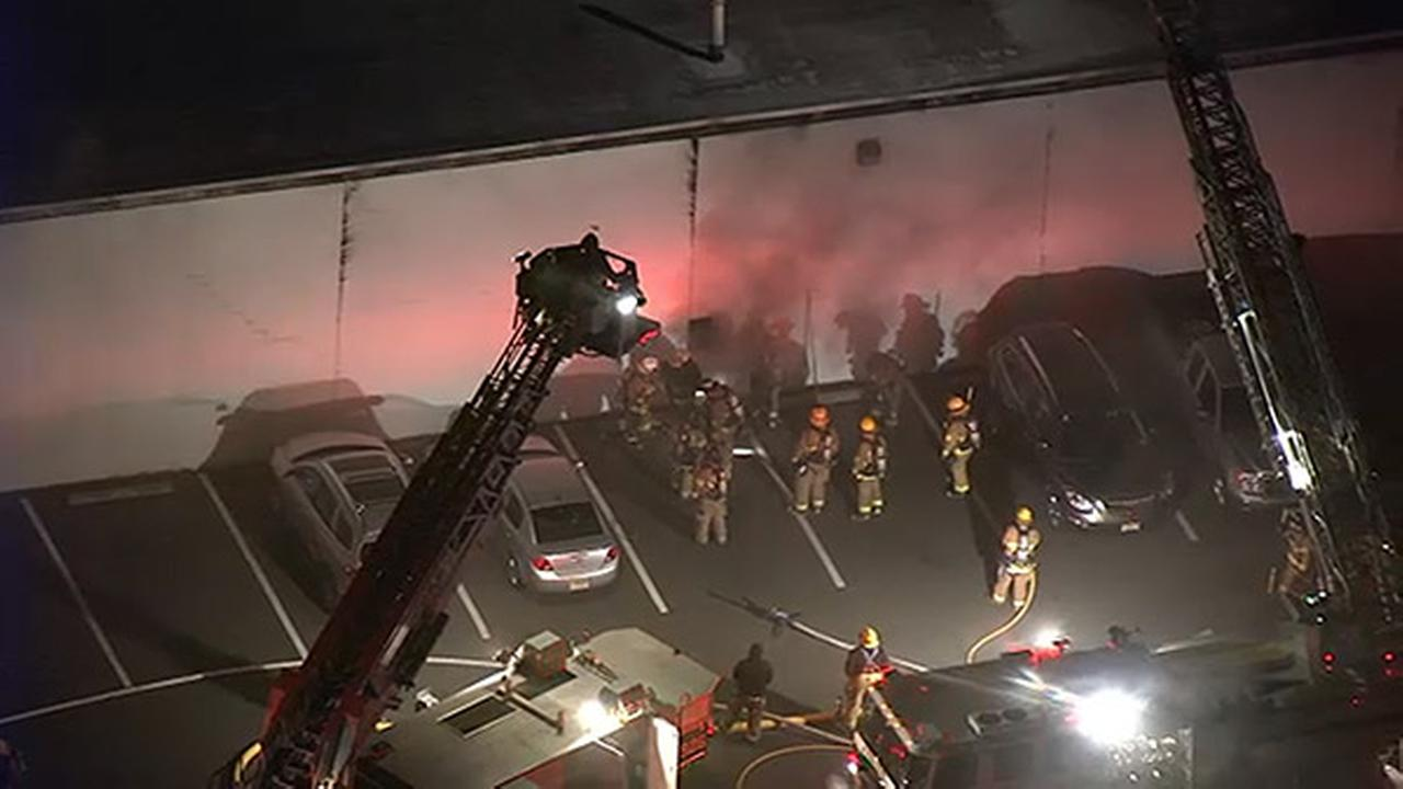 Crews battle 2-alarm fire at Woodbury car dealership