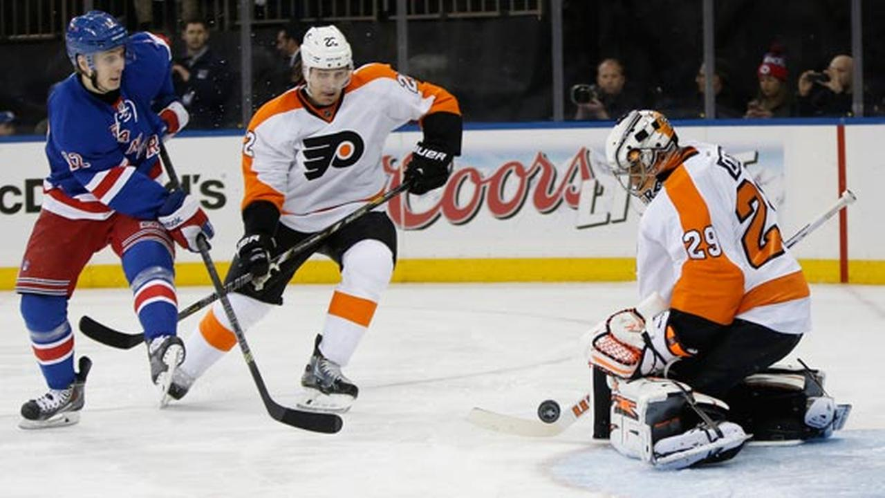 Flyers goalie Ray Emery (29) blocks a shot by Rangers right wing Jesper Fast (12) in Game 2 of the first round of the Stanley Cup hockey playoffs, Sunday, April 20, 2014.