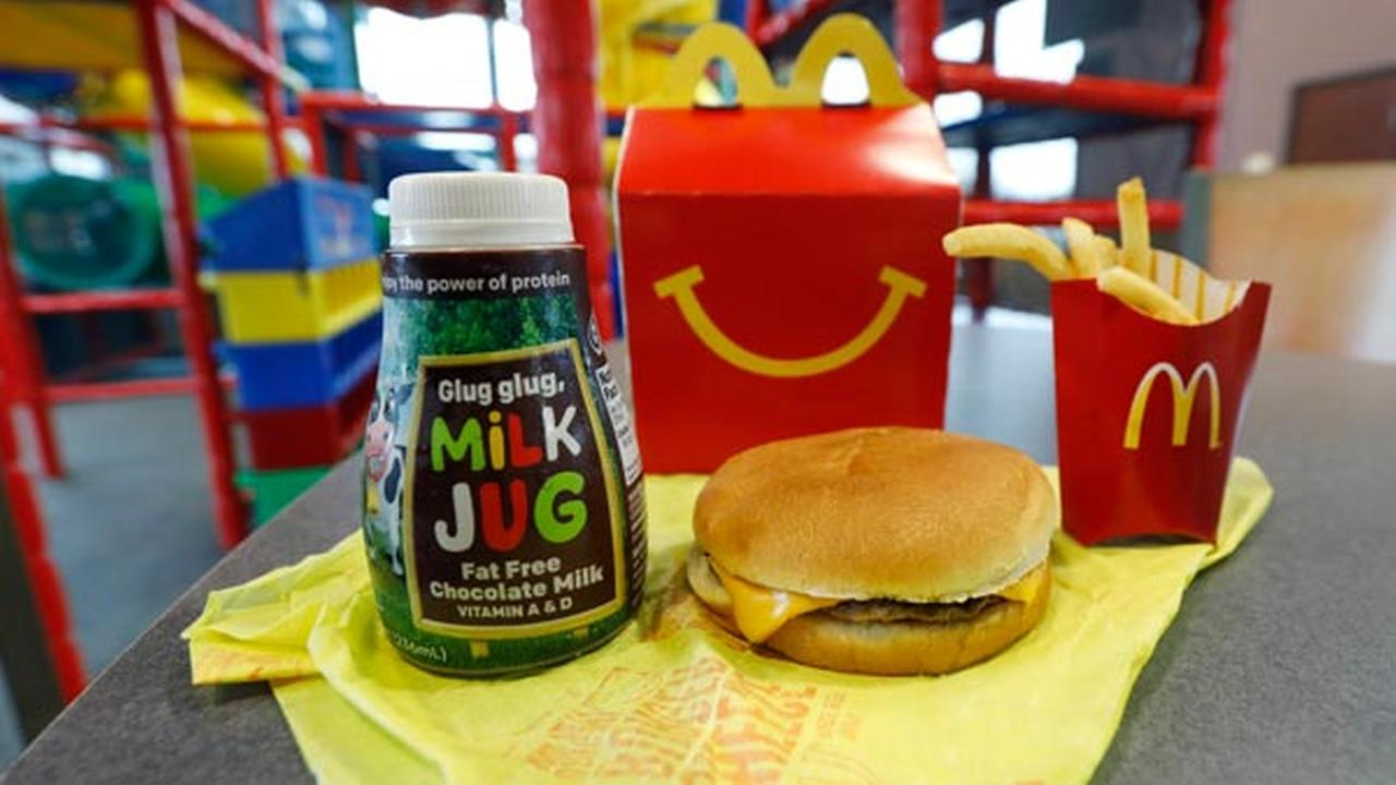 A Happy Meal featuring non-fat chocolate milk and a cheeseburger with fries, are arranged for a photo at a McDonalds restaurant in Brandon, Miss., Wednesday, Feb. 14, 2018.