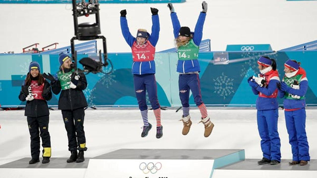 US Jessica Diggins, right, and Kikkan Randall celebrate after winning the gold medal in the womens team sprint freestyle cross-country skiing final at the Winter Olympics.