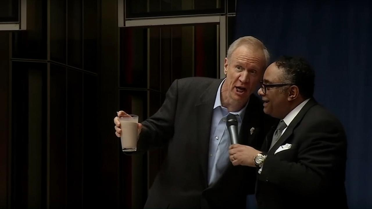 Illinois governor participates in diversity demonstration involving a glass of milk