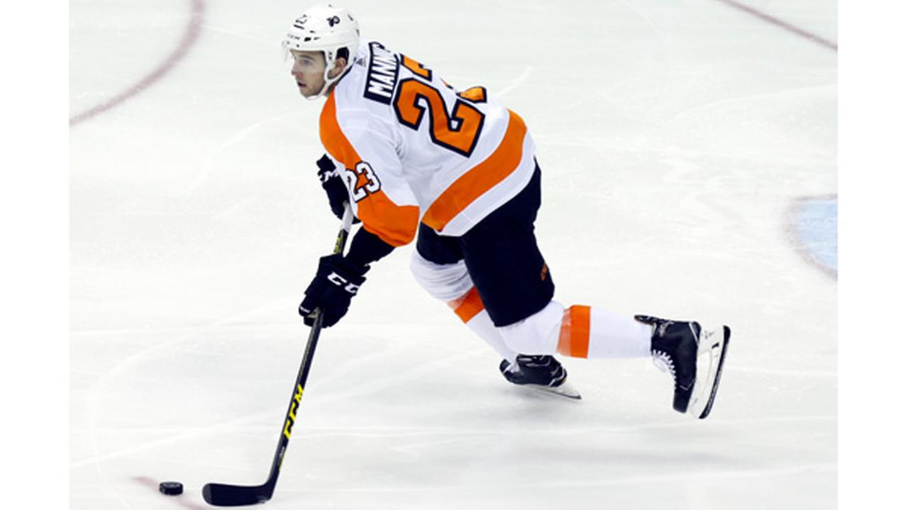 FILE: Philadelphia Flyers defenseman Brandon Manning carries the puck against the Columbus Blue Jackets during an NHL hockey game in Columbus, Ohio, Friday, Feb. 16, 2018.