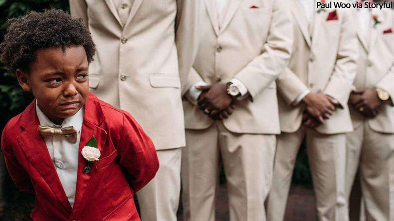Boys emotional reaction to mother walking down aisle goes viral