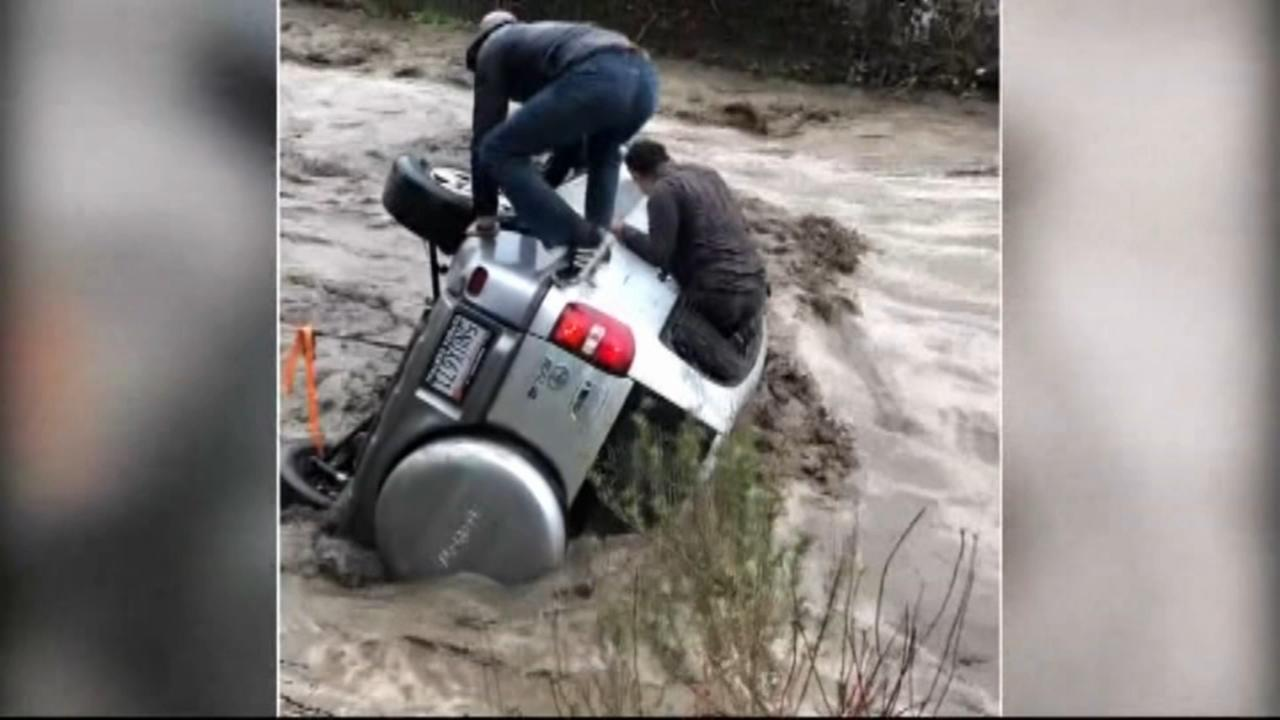 Man trapped in car swept away by floodwaters