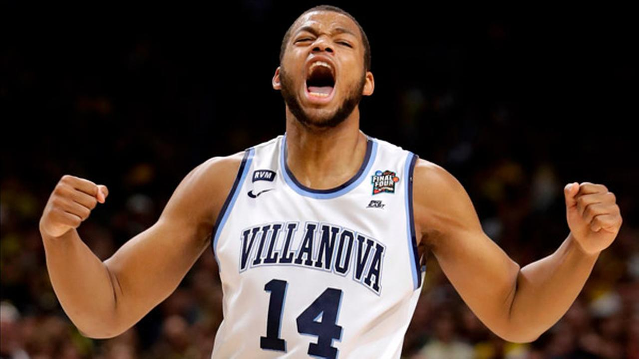Villanova forward Omari Spellman celebrates during the first half against Kansas in the semifinals of the Final Four NCAA basketball tournament, March 31, 2018, in San Antonio.