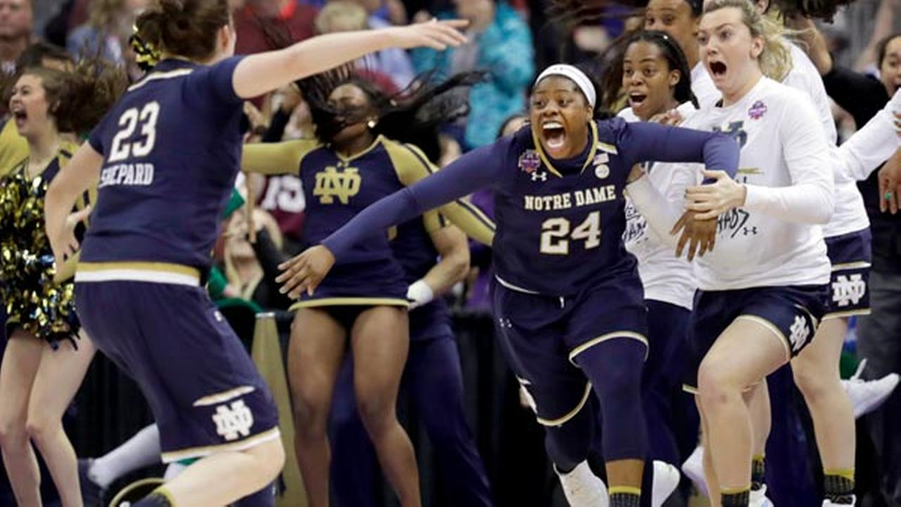 Notre Dames Arike Ogunbowale (24) is congratulated by teammate Jessica Shepard (23) after sinking a 3-point basket to defeat Mississippi State.