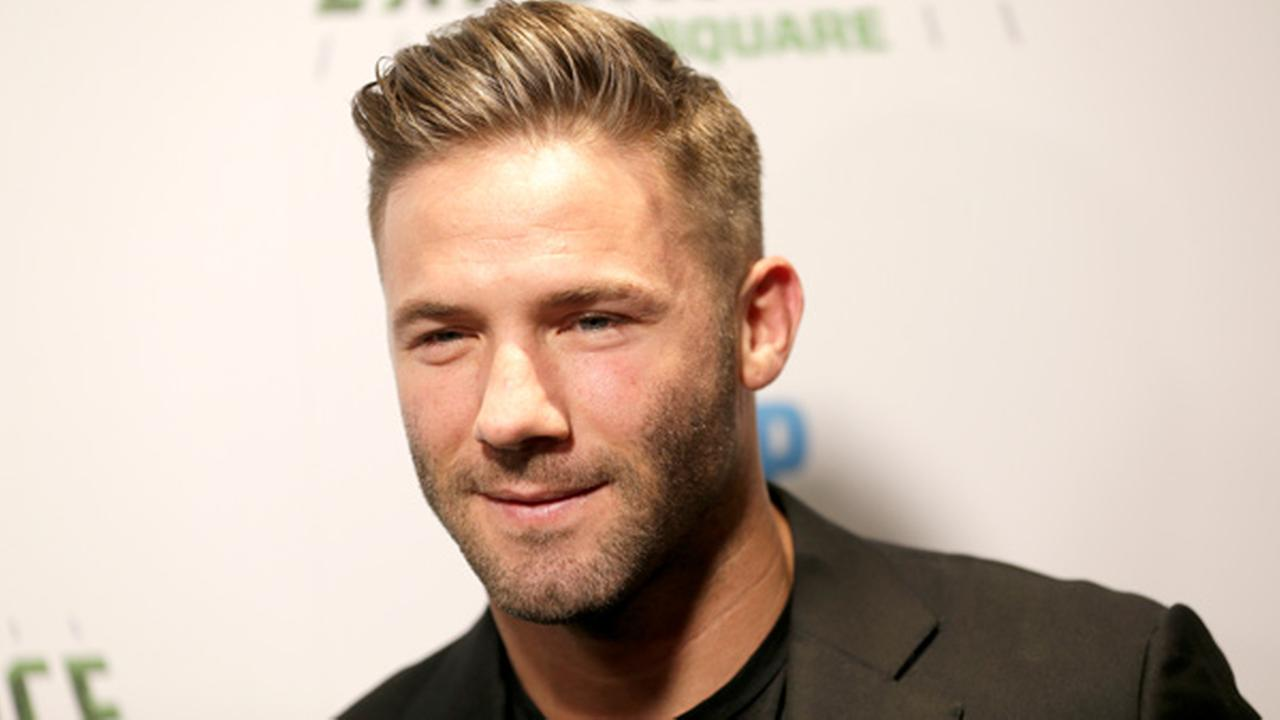 New England Patriots Julian Edelman poses for a picture at the opening of NFL Experience in Times Square, New York, Thursday, Nov. 30, 2017.