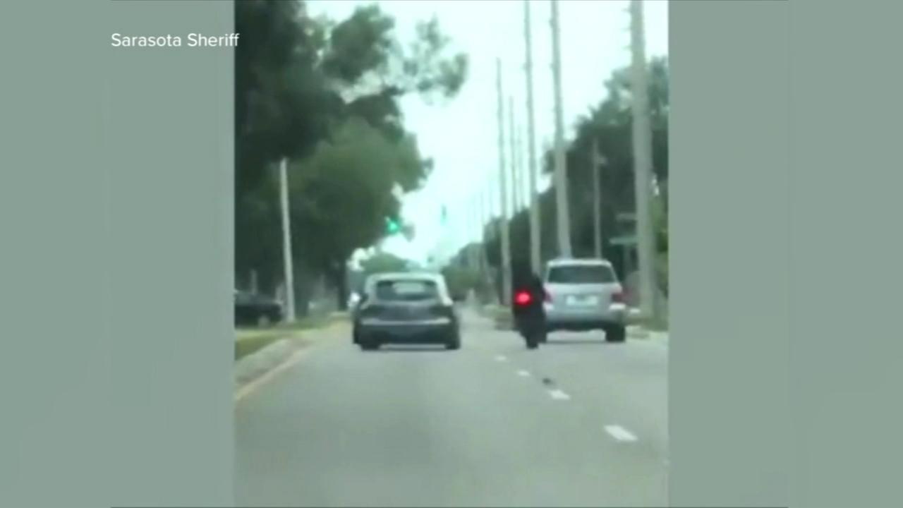 Car rams motorcyclist in suspected road rage incident