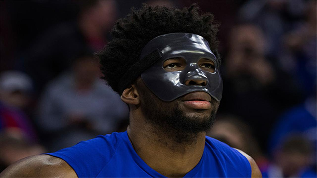Philadelphia 76ers Joel Embiid looks on while wearing a mask prior to an NBA basketball game against the Milwaukee Bucks.