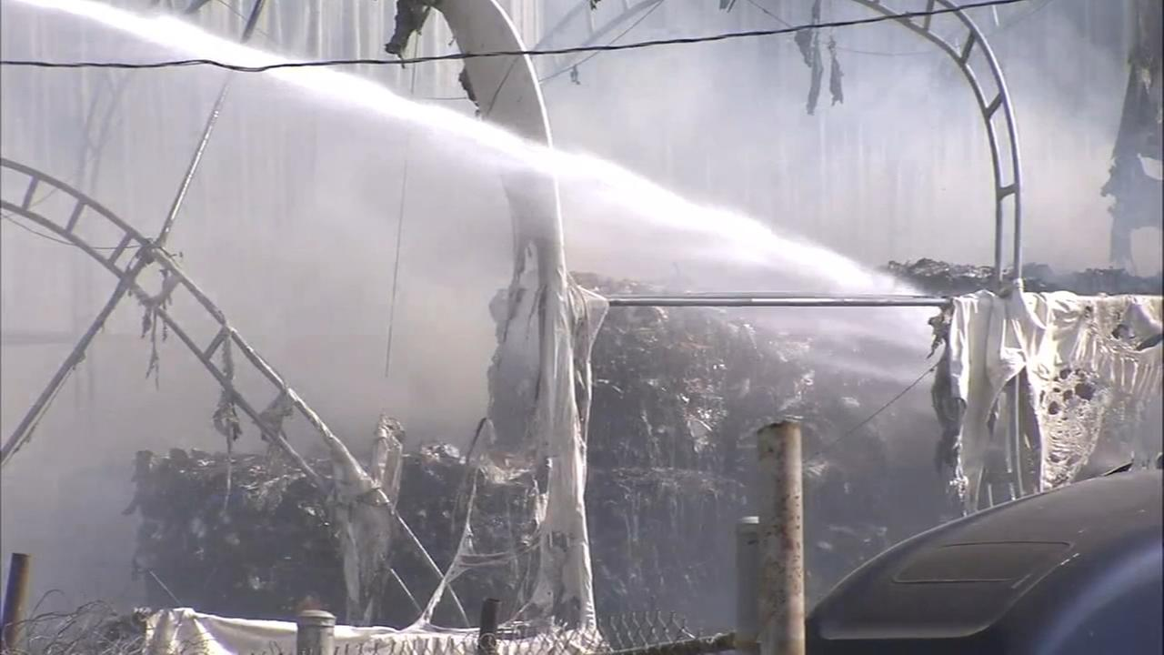 Crews battle fire at recycling facility in Camden