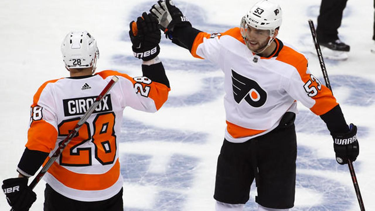 Philadelphia Flyers Shayne Gostisbehere (53) celebrates his goal with Claude Giroux (28) during the first period in Game 2.