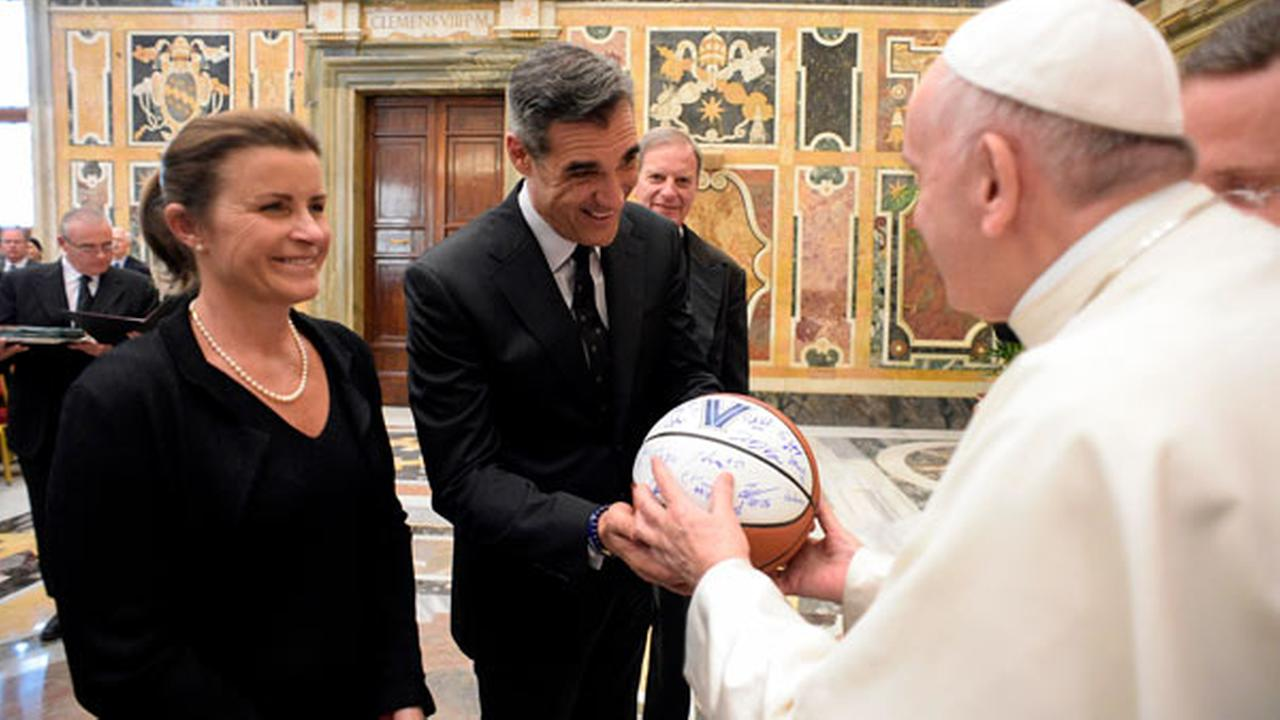 This Saturday, April 14, 2018 photo, shows Villanovas coach Jay Wright with his wife Patricia Reilly presenting Pope Francis with a basketball during an audience at the Vatican.
