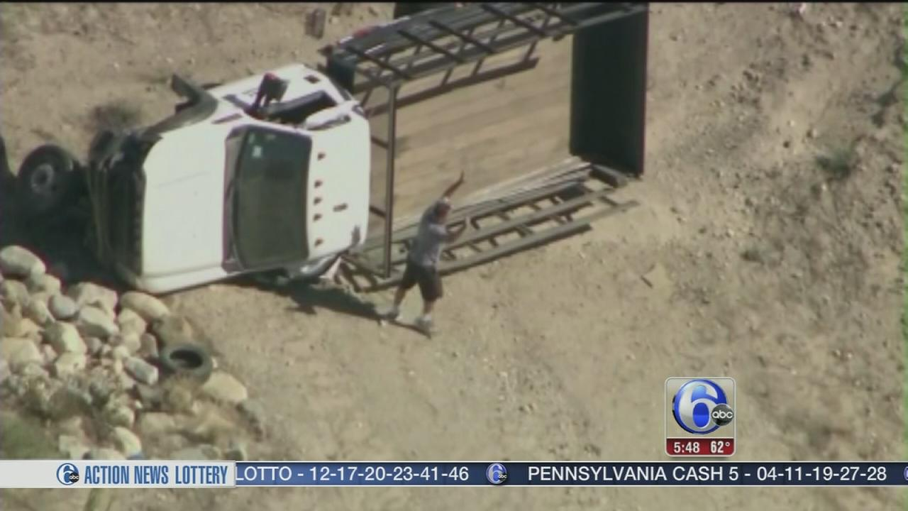 VIDEO: Truck rolls off freeway in police chase