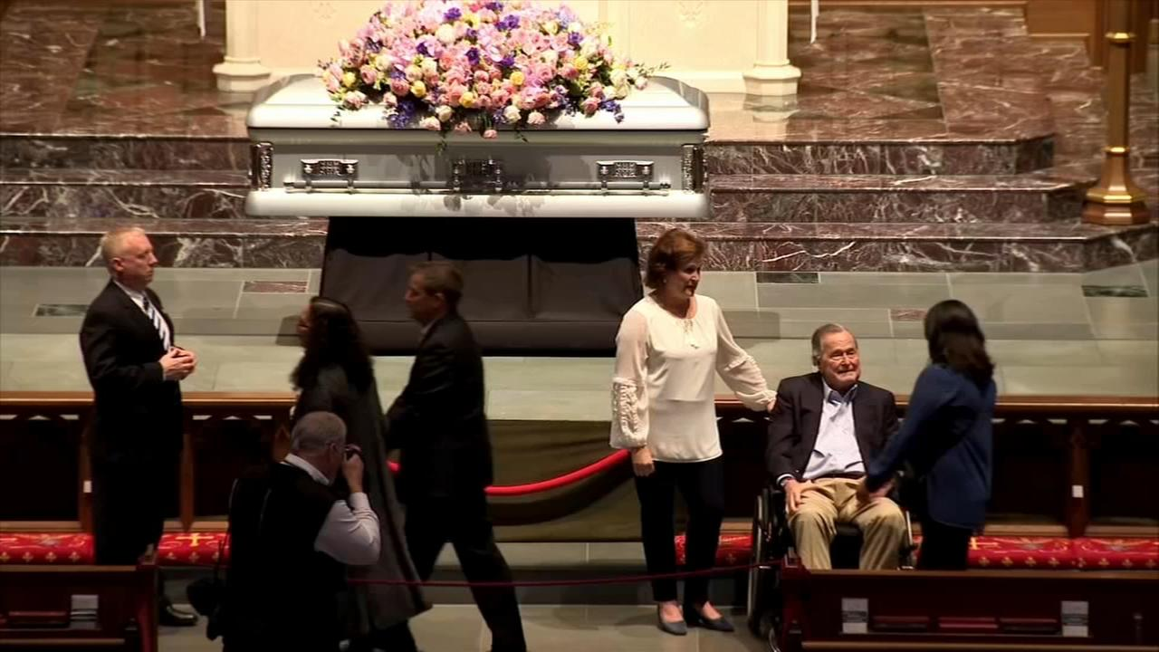 President George HW Bush greets mourners honoring his wife