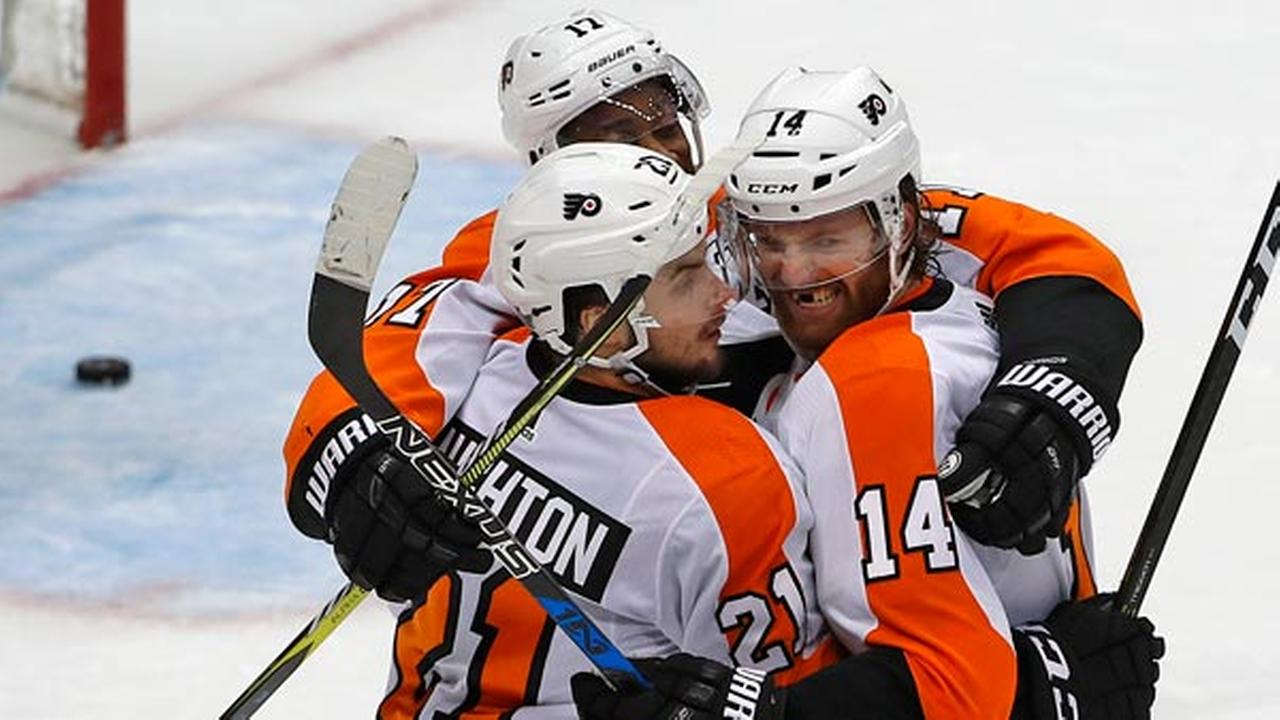 Philadelphia Flyers Sean Couturier (14) celebrates his goal with Scott Laughton (21) and Wayne Simmonds during the third period in Game 5.
