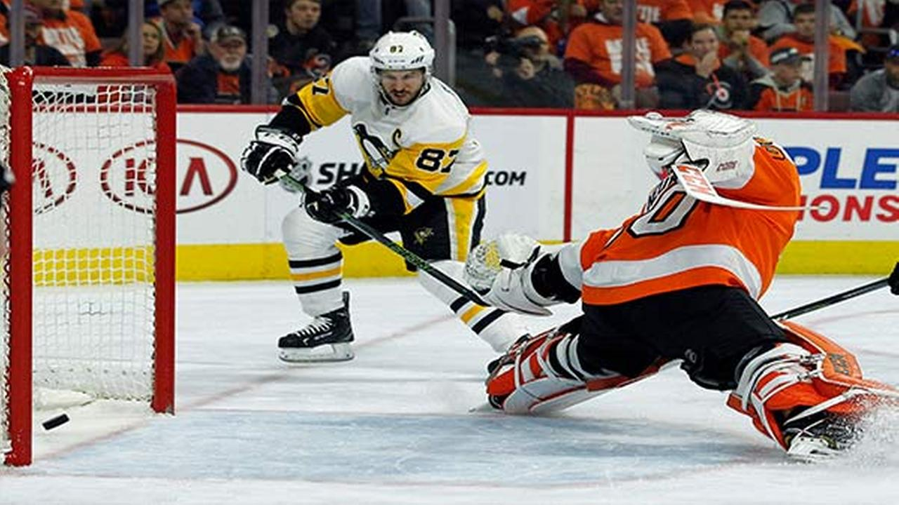 Pittsburgh Penguins Sidney Crosby, left, scores past Philadelphia Flyers Michal Neuvirth during the first period in Game 6 of an NHL first-round hockey playoff series.