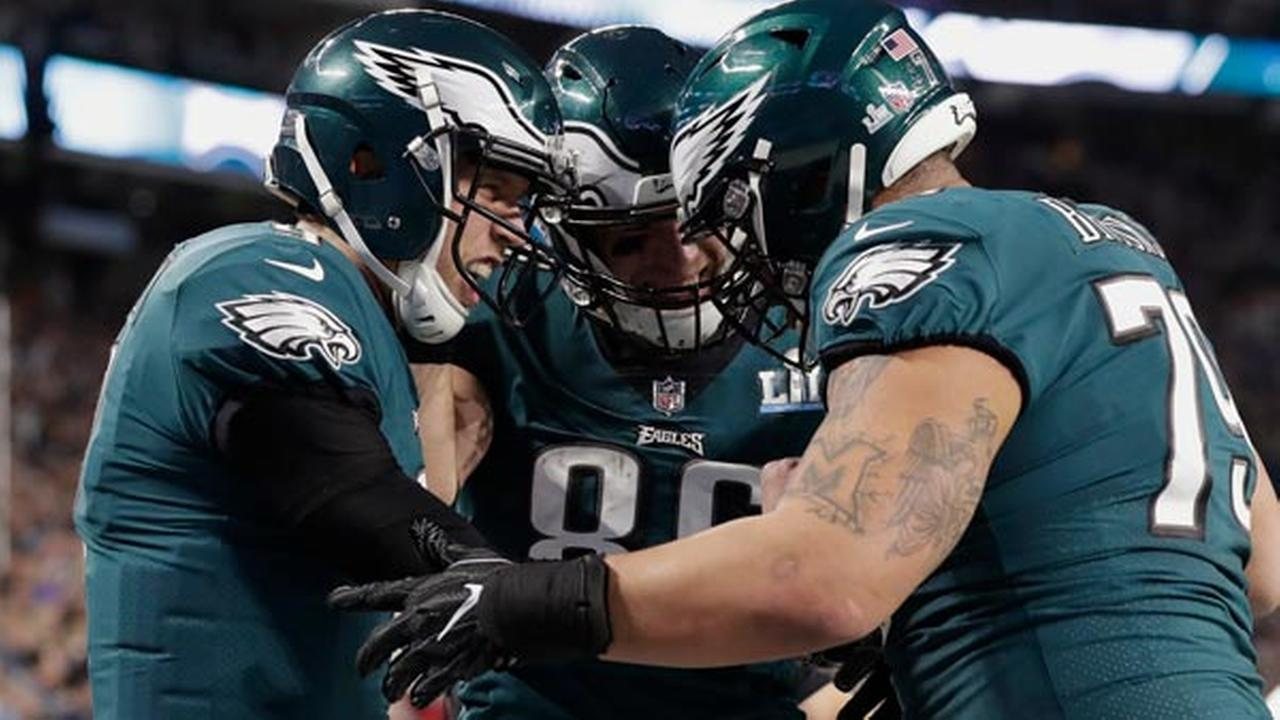 Eagles quarterback Nick Foles, left, celebrate a touchdown with tight end Zach Ertz (86) and offensive guard Brandon Brooks (79), during the first half of the NFL Super Bowl 52.