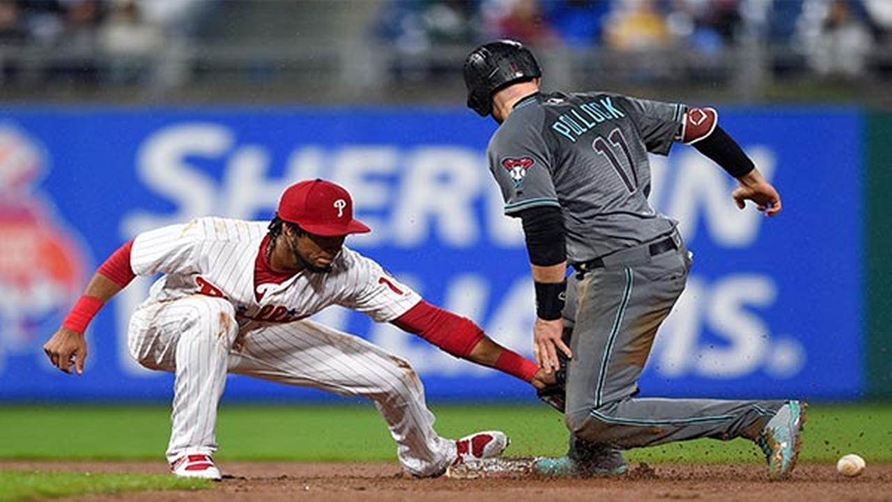 Arizona Diamondbacks A.J. Pollock, right, slides safely past the tag of Philadelphia Phillies Pedro Florimon to steal second base during the eighth inning Tuesday, April 24.