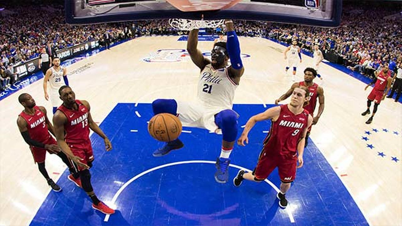 In this photo taken with a fisheye lens, Philadelphia 76ers Joel Embiid dunks the ball during the first half in Game 5 of a first-round NBA basketball playoff series.