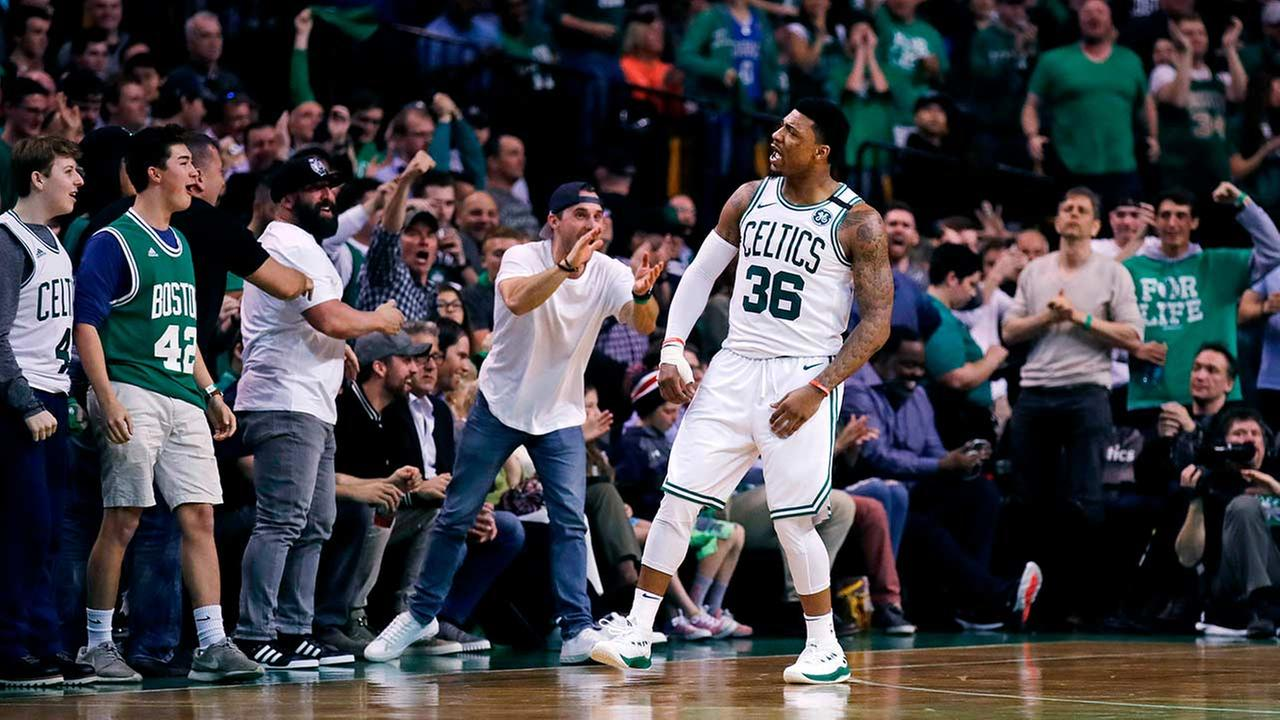 Boston Celtics guard Marcus Smart (36) celebrates a basket with fans (AP Photo/Charles Krupa)