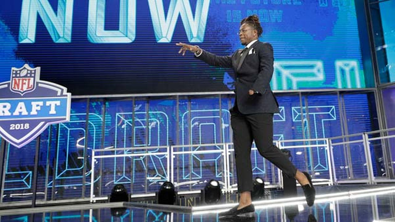 Central Floridas Shaquem Griffin walks out onto the stage at the start of the first round of the NFL football draft, Thursday, April 26, 2018, in Arlington, Texas.