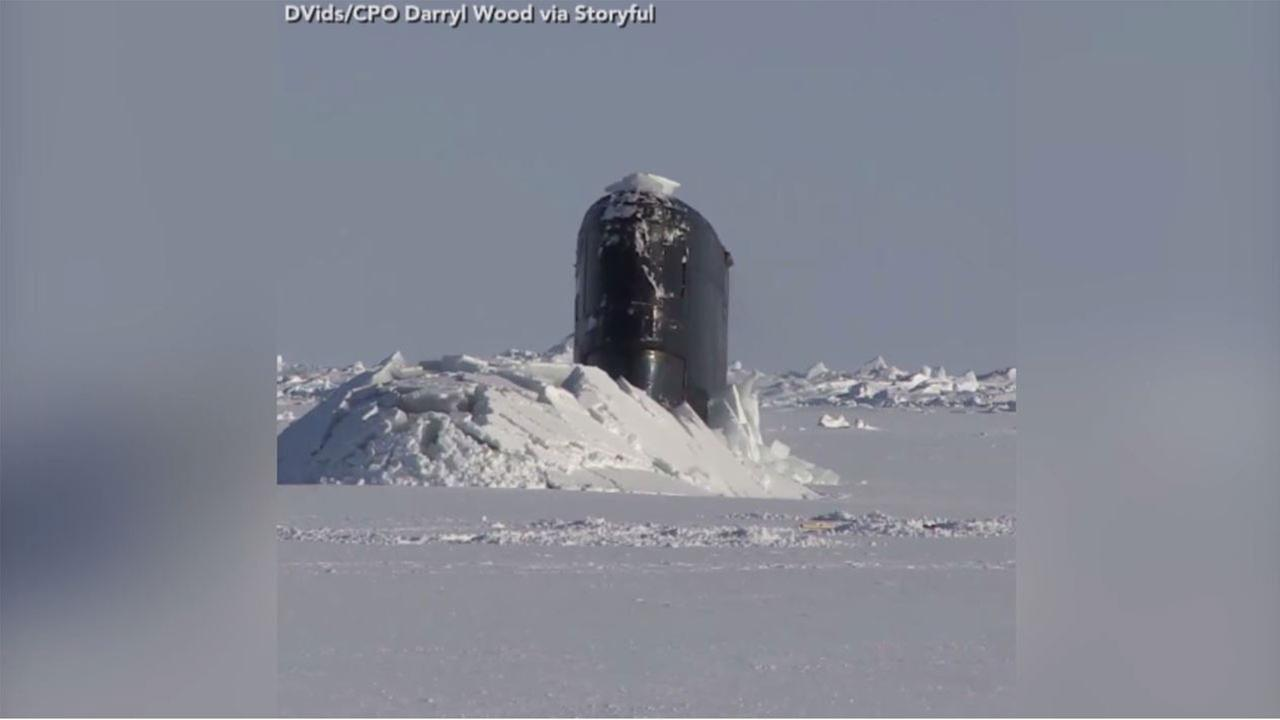 Royal Navy submarine breaks through thick ice during training exercise