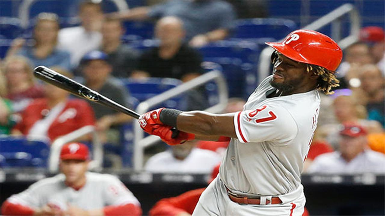 Philadelphia Phillies Odubel Herrera hits a single during the first inning of a baseball game against the Miami Marlins, Monday, April 30, 2018, in Miami.