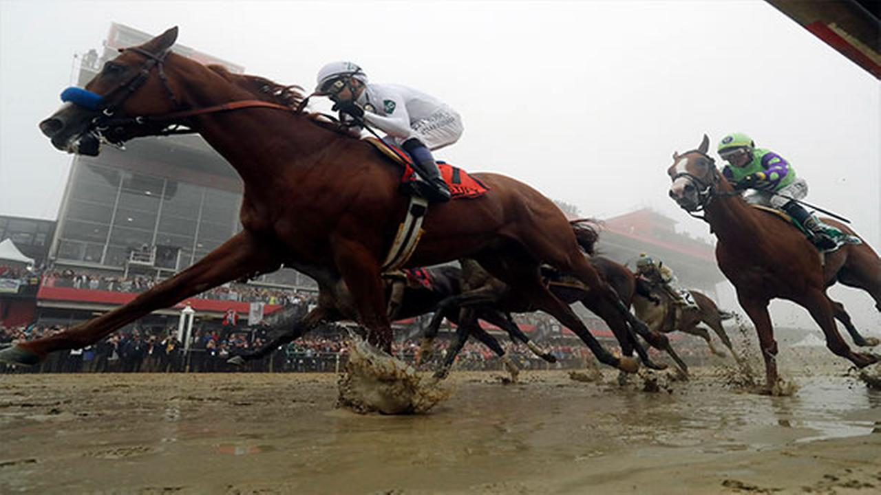 Justify with Mike Smith atop wins the 143rd Preakness Stakes horse race at Pimlico race course, Saturday, May 19, 2018, in Baltimore.