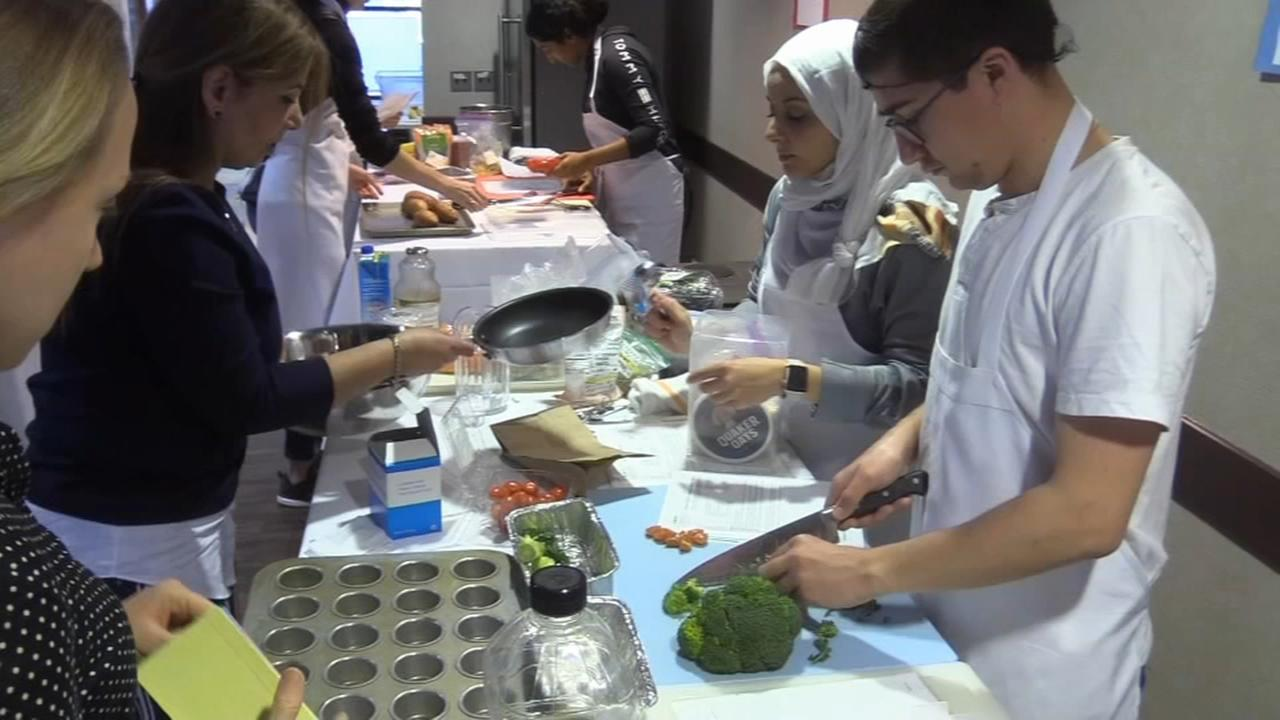 Medical students studying nutrition head into the kitchen